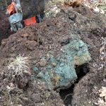 Discolored soil in test pit